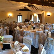 Neutral beige hesian with white lace overlay double sashes over ivory cotton chair covers