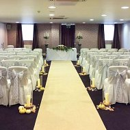 Silver grey satin and lace double sash over white chair covers complete with ivory aisle carpet runner