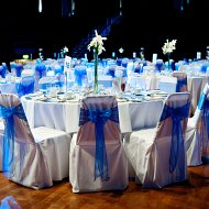 Cobalt bright blue organza sash bows over white cotton chair covers