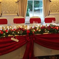 Romantic red taffeta top table swagging with bow decoration