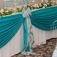 Teal top table swagging complete with teal and ivory lace flock double bow decoration