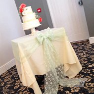 Gorgeous green chiffon cake table sash with white lace overlay and bow