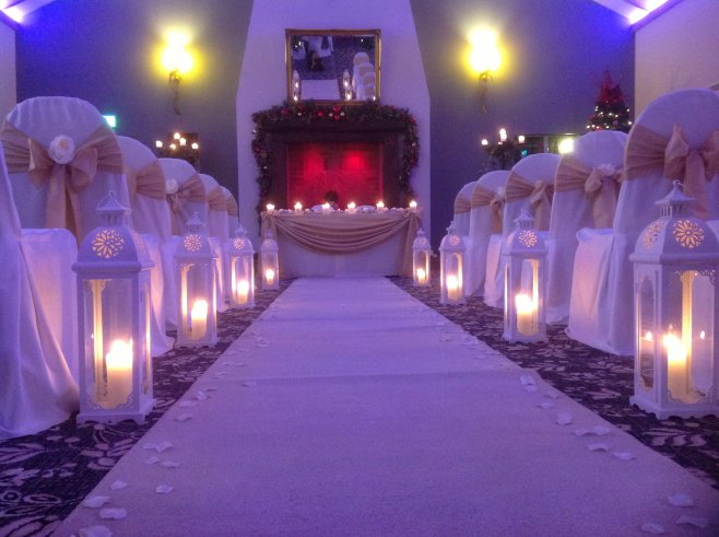 Stunning aisle lanterns provide a romantic, ambient feel