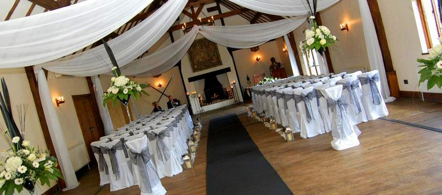 pristine white cotton chair covers with silver organza bow sashes